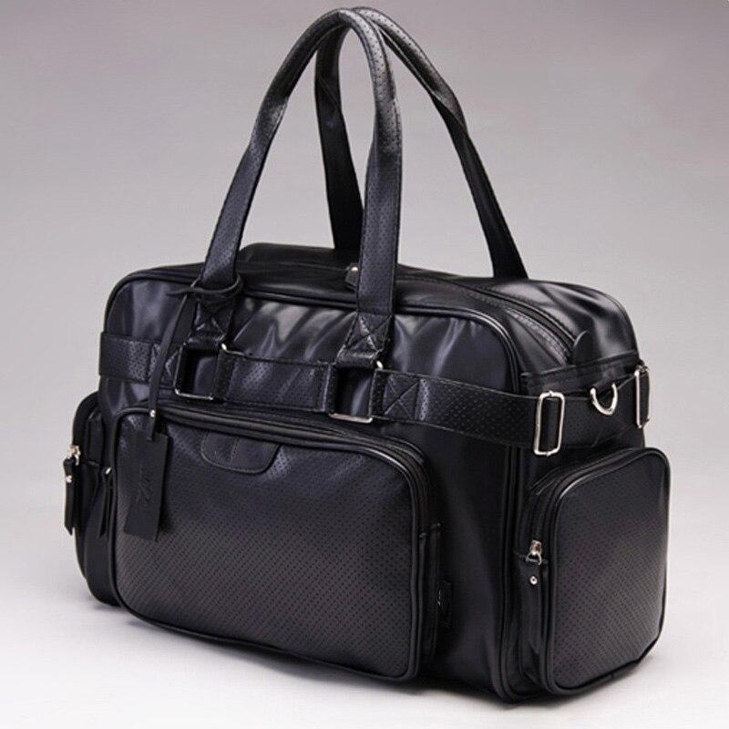 Bagaj ve Çantalar'ten Seyahat Çantaları'de Yeni stil erkekler seyahat çantası moda tasarımcısı erkek çanta omuz çantaları büyük kapasiteli pu deri silindir çanta PT1097'da  Grup 1