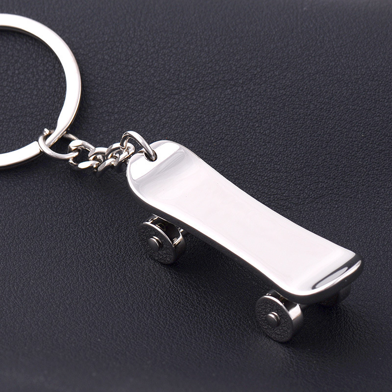 100 Pcs/lot Skateboard Keychain Neuheit Casual Metall Schmuckstück Paar Skateboard Schlüssel Kette Ring Halter Souvenir Schmuck Geschenk