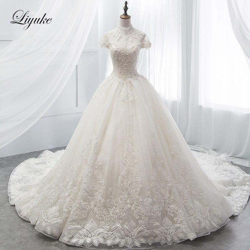 Liyuke Luxurious Chapel Train Ball Gown Wedding Dress With Short Sleeve Elegant Beading Vestido de boda