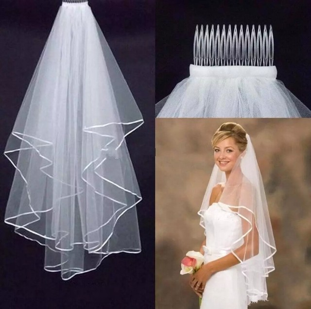 Vestidos de novia con manga y velo
