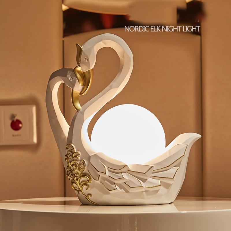 Здесь продается  Nordic Design Endless Love Swan Table Lights Loft LED Bedside Desk Lamps Creative Art Deco Table Lamps for Living Room  Свет и освещение