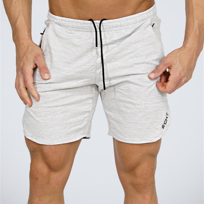 Verano mens shorts Calf-longitud Fitness Bodybuilding moda Casual gimnasios Joggers entrenamiento Crossfit marca pantalones cortos deportivos