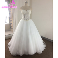 Ball Gown Wedding Dresses Cheap Bridal Gowns Spring Sexy Sweetheart Corset See Through Beaded Pearls Sequins Hot Selling Wedding