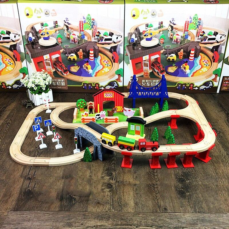 2019 vente chaude 82 pièces Train en bois piste ensemble hêtre Rail voiture piste assemblé modèle blocs de construction Puzzle jouet pour enfants
