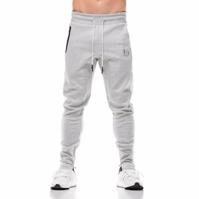 8bf395cd Aliexpress.com: Comprar Hombres pantalones casuales 2018 nuevos hombres  pantalones Jogger hombres Fitness Bodybuilding Gyms pantalones para los ...
