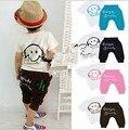 2013 nuevos cabritos fijados desgaste del verano de manga corta set Multicolor niños traje blanco en la ropa cara sonriente de la camiseta + pantst envío gratuito