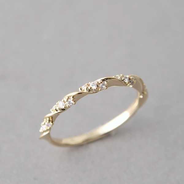 แฟชั่นงานแต่งงานแหวนคู่รัก Micro-แทรก Cubic Zirconia หมุนแหวน Rose Gold สีแฟชั่นเครื่องประดับ