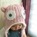 Otoño e invierno suéter nuevo grandes ojos de dibujos animados los niños gorro de lana mano tejer sombrero caliente al aire libre