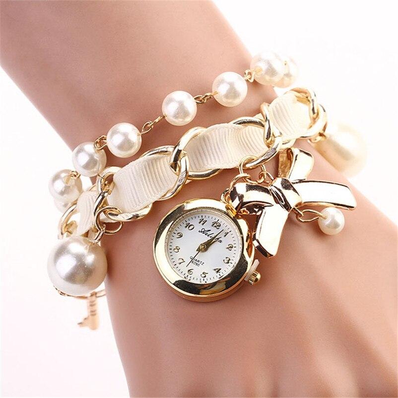 Женские часы на жемчужном браслете