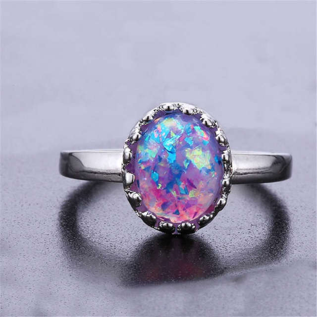 Elegant round purple fire opal ring jewelry refers to wedding wedding silver col