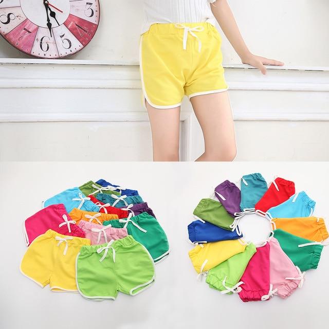 SheeCute abbigliamento bambini nuovo ragazze colore della caramella breve ragazzi di estate pantaloni spiaggia pantaloni di bicchierini 0902 4