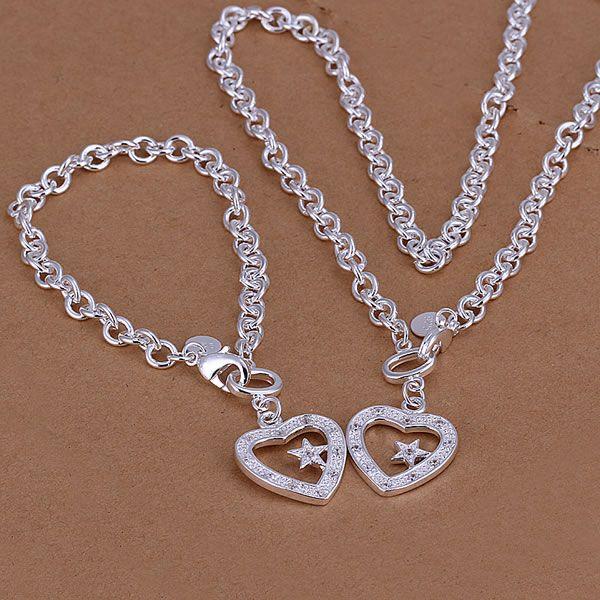 1.46 in x 0.87 in Jewel Tie Sterling Silver Antiqued Heart Cross Pendant