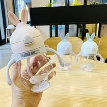 все цены на Baby Kids Cute Rabbit Water Bottle Children Learn Training Cup Drink Water Straw Handle Bottle School Drinking Food Milk Bottles онлайн