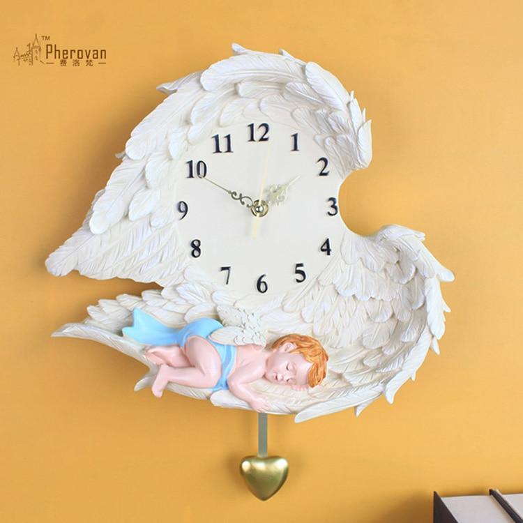 Angel clock watch the living room wall decoration art personality of European pastoral children hanging pendulum clock