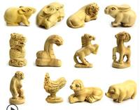 wooden carving zodiac animal signs in the yellow poplar tree handlebar Tiger rabbit, dragon snake and horse Sheep statue Home