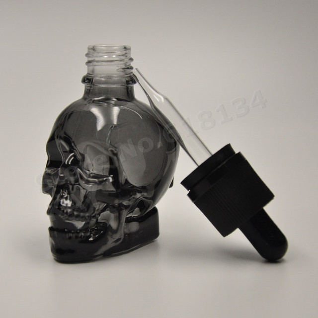 30ml skull bottle 30ml frosted black skull shape glass dropper bottle with child proof