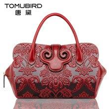 TOMUBIRD Genuine leather Dumplings type Genuine leather handbag Head layer cowhide woman  Portable oblique cross package