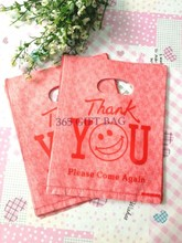 100pcs/lot Orangered Cute Face Plastic Recyclable Useful Packaging Bags Shopping Hand Bag Protable Boutique Gift Carrier 15*20cm(China (Mainland))