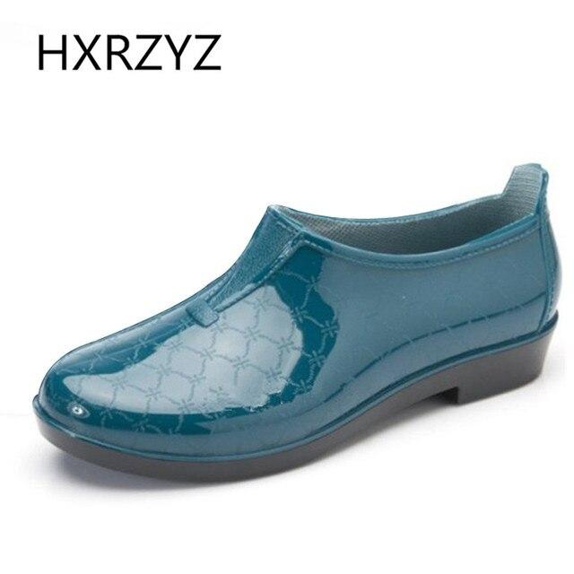 Baixo para ajudar um pedal mulheres planas de borracha sapatos de chuva e botas de chuva / grátis frete primavera e outono das mulheres à prova d ' água ankle boots