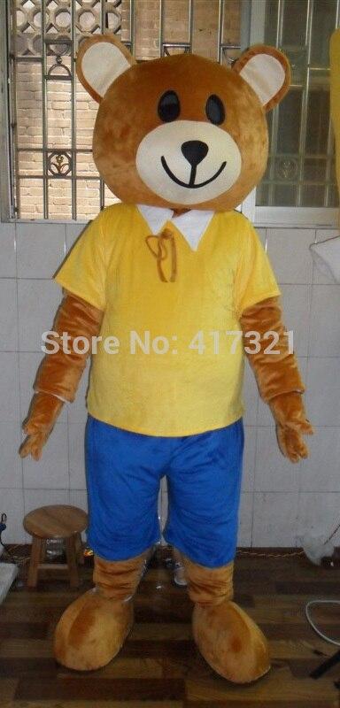 ᑎ‰Oso que lleva un amarillo camiseta mascota traje adulto mascota ...