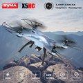 Syma x5hc 4-ch 2.4 ghz 6-axis rc quadcopter con cámara de 2mp hd auto flotando headless modo drone rc helicóptero quadrocopter toys