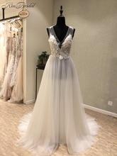 Фотография Sexy New Beach Wedding Dresses 2018 V-neck Sleeveless A-Line Floor Length Appliques Chiffon Cheap Bridal Gowns Vestido longo