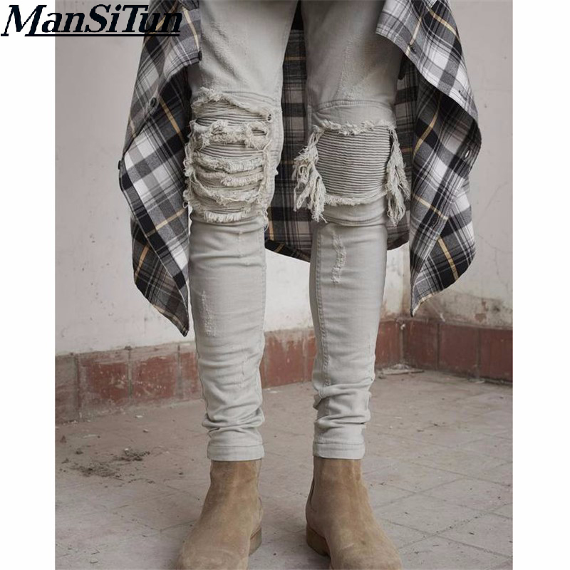 Man si Tun In 2017, the latest American hip hop fashionable man midnight blue roadworn bicycle cowboy destroy plait ripped jeans
