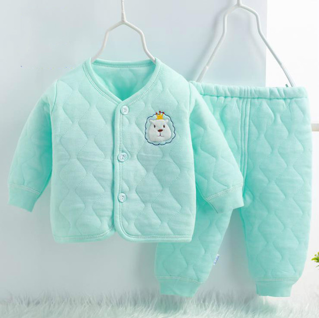 The newborn's thermal underwear set, with a cartoon top.