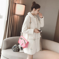 White woolen coat female 2017/18 new winter flowers in the long section of Korean heavy embroidery wool coat are single breasted