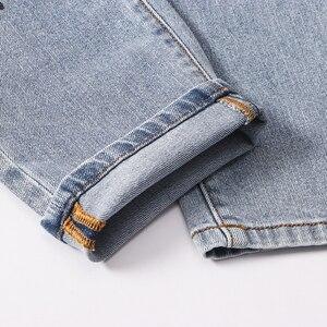 Image 5 - بنطلون جينز للرجال مطبوع عليه زهرة الملاك من Sokotoo بنطال جينز من قماش الدنيم المطاطي بقصة ضيقة