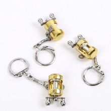 1 Piece Gold Color Fish Wheel key Chains Fly Fisherman Wheel Miniature Fishing Reels Keychain Small Pendant for Fishing Lover
