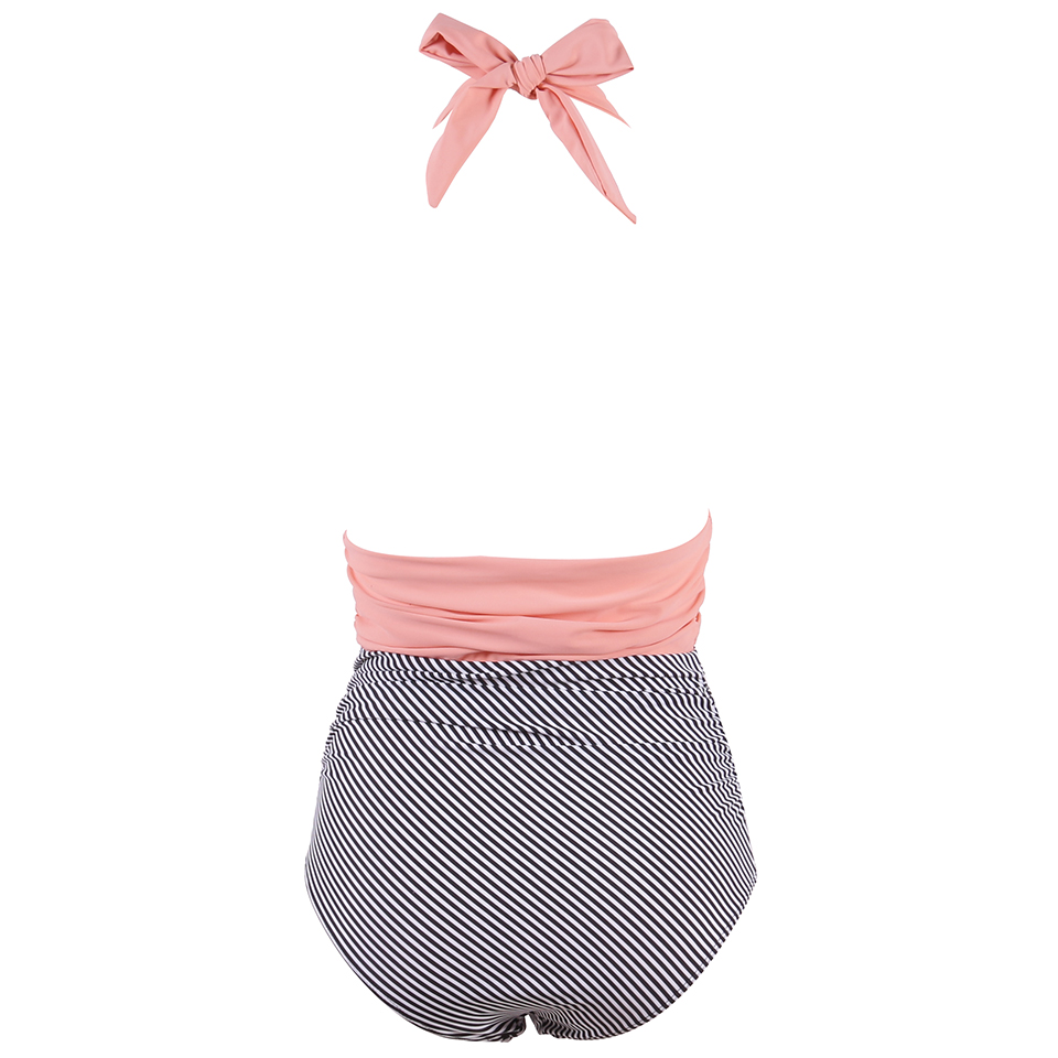 Foto from the back of pink color new one piece swimsuit for beach. Swimming backless v-neck for women