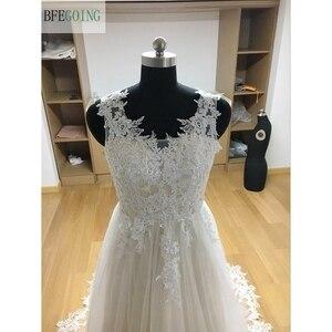 Image 5 - Ngà Tulle V Cổ Tầng Dài A Line Wedding dresses Chapel Train Không Tay Bridal Gown Custom made