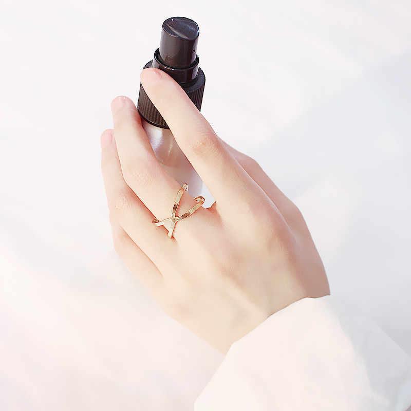 ใหม่ minimalist แหวน X cross สามมิติ hollow surround แหวนนิ้วมือคอลเลคชั่นอุปกรณ์เสริมเครื่องประดับโลหะ
