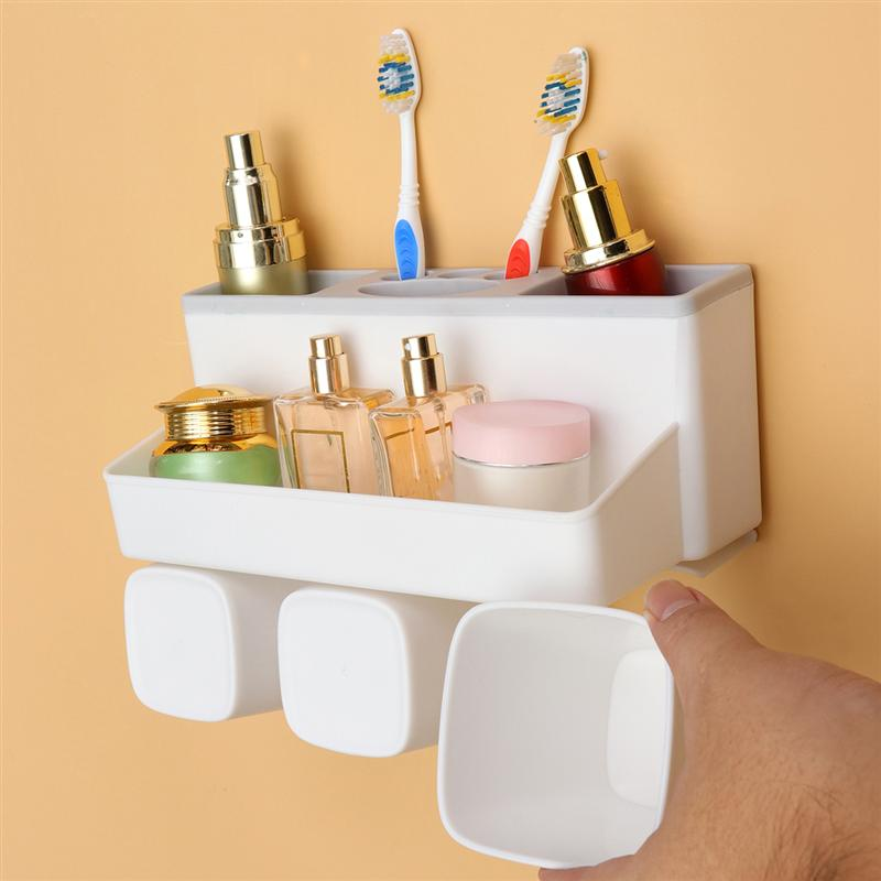 Image 1 - Bathroom Toothbrush Holder Wall Mounted Washing Traceless Punch Free Storage Basket Cup Storage Shelf For Home Bathroom-in Toothbrush & Toothpaste Holders from Home & Garden