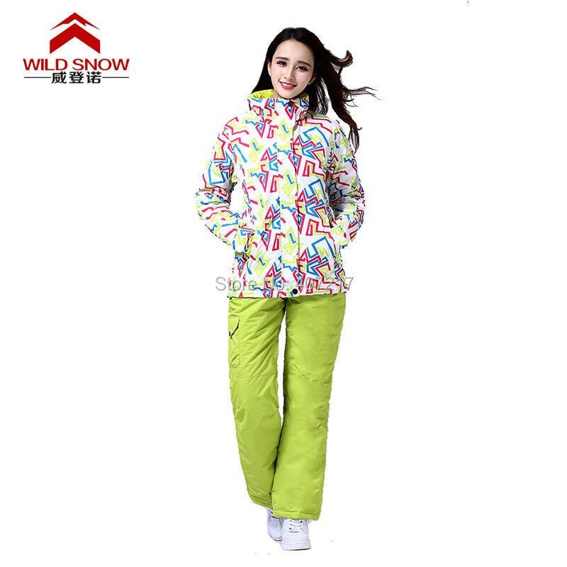 Prix pour 2016 femmes couleur courbe combinaison de ski féminin snowboard ski costume neige costume blanc veste de ski + fruits vert ski pantalon vêtements de ski