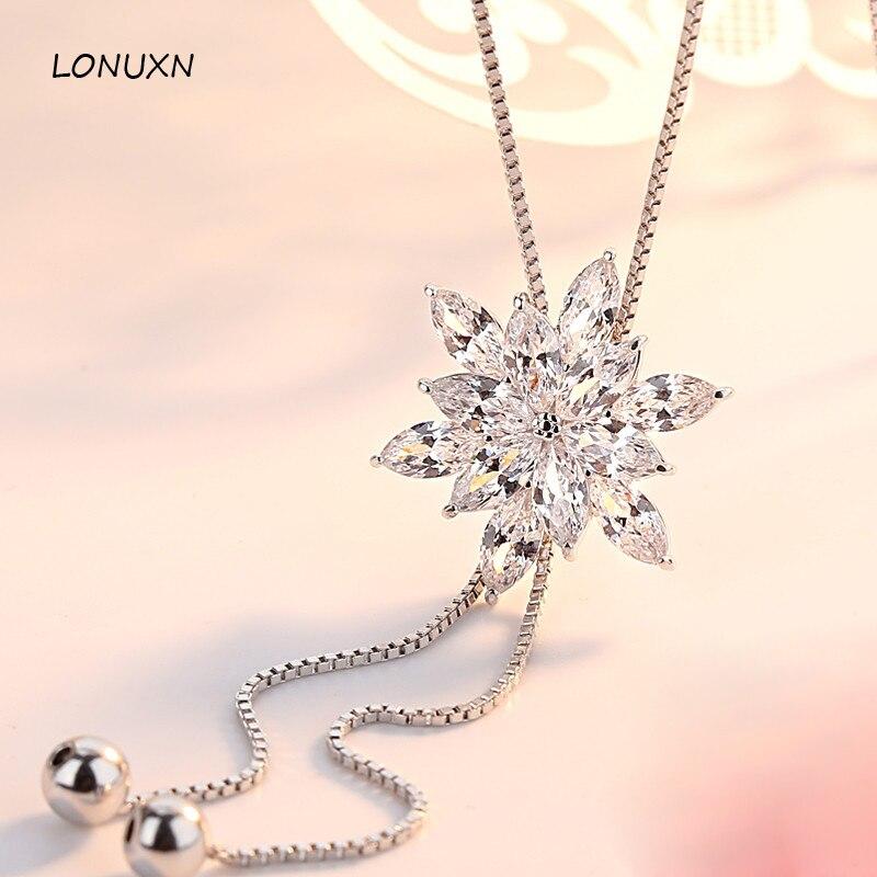 Haute qualité gland femme bijoux nouveau collier flocon de neige femme caractère pendentif mode simple longues filles perles chandail chaîne