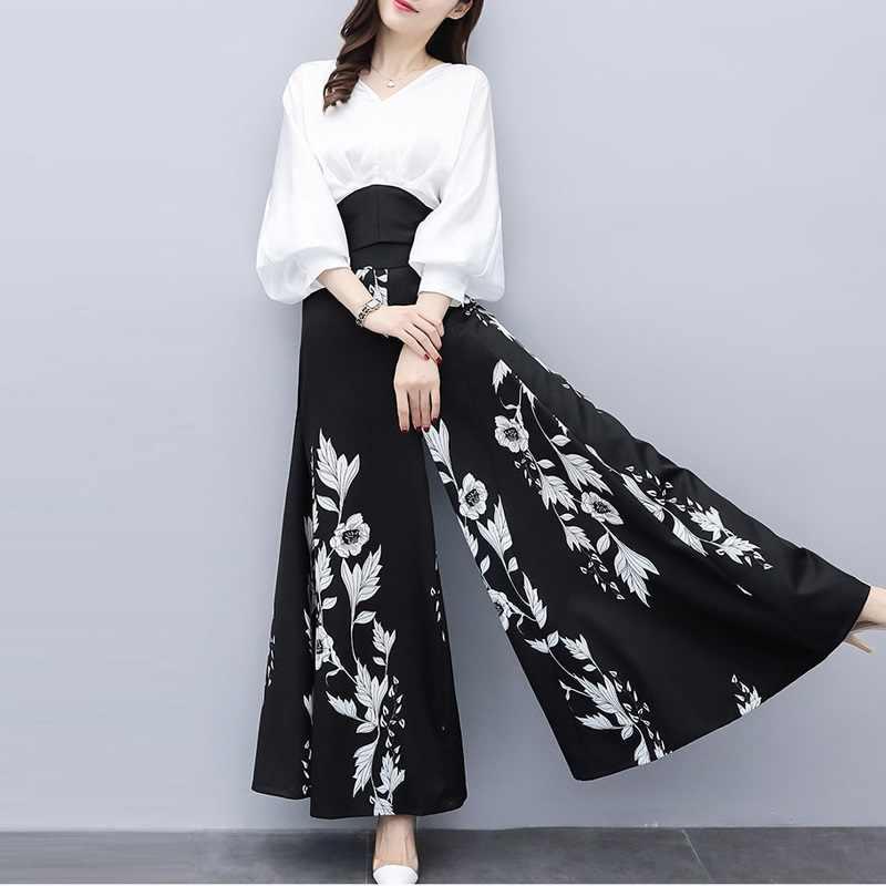 Шифоновый Повседневный брючный костюм 2018 новый модный элегантный комплект из двух предметов Женская белая блузка и черный цветочный принт широкие брюки костюм