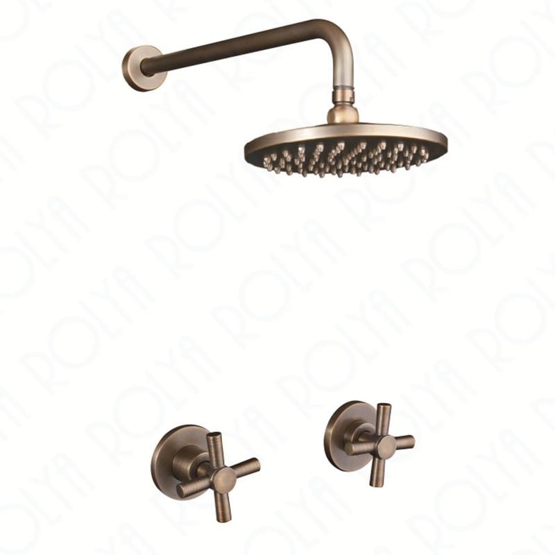 antique brass shower set in wall