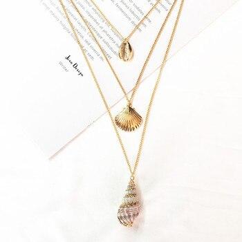 8bf715cc9286 De moda de Cowrie Shell concha de mar colgante de collar para las mujeres  de Color oro largo a capas collar de gargantilla de cadena declaración  Collares