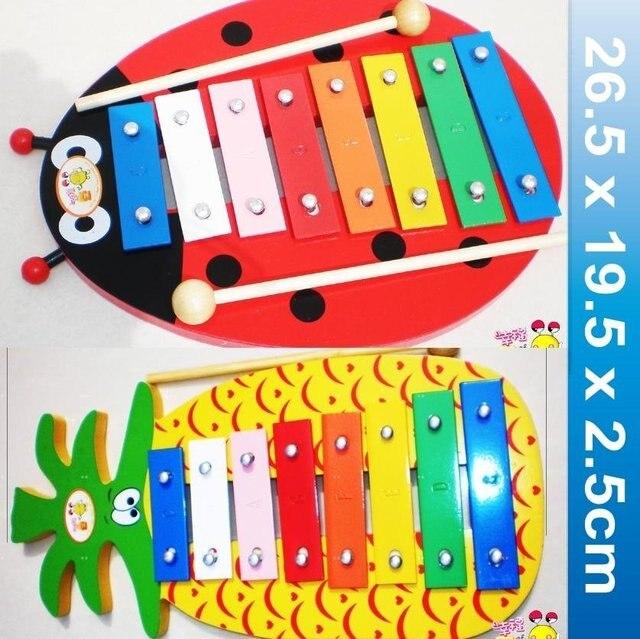Educational percussion instrument toy:Vibraphone,8 tones aluminium+wood harp.Red lady beetle/ananas background.