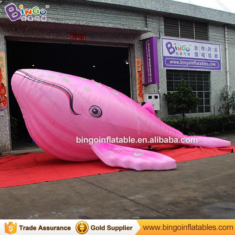 La baleine gonflable géante promotionnelle de 7 mètres de long a adapté le type de vie marine à la baleine de couleur rose pour le jouet gonflable d'affichage