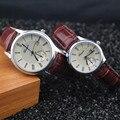 A prueba de agua! banda de cuero genuino, caso plateado, función de fecha automática, gerryda moda amante pareja de cuarzo reloj