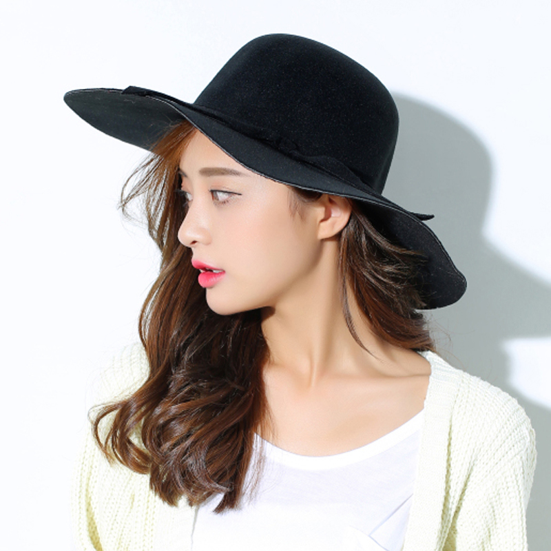 70e319d45ef European and American big brim women woolen hat Dome pure color wave brim Fedora  hat