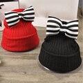 Nueva llegada del bebé hat linda mariposa nudo niños de lana sombrero niños cálido sombrero del ganchillo del bebé de kawaii del sombrero del invierno de las muchachas