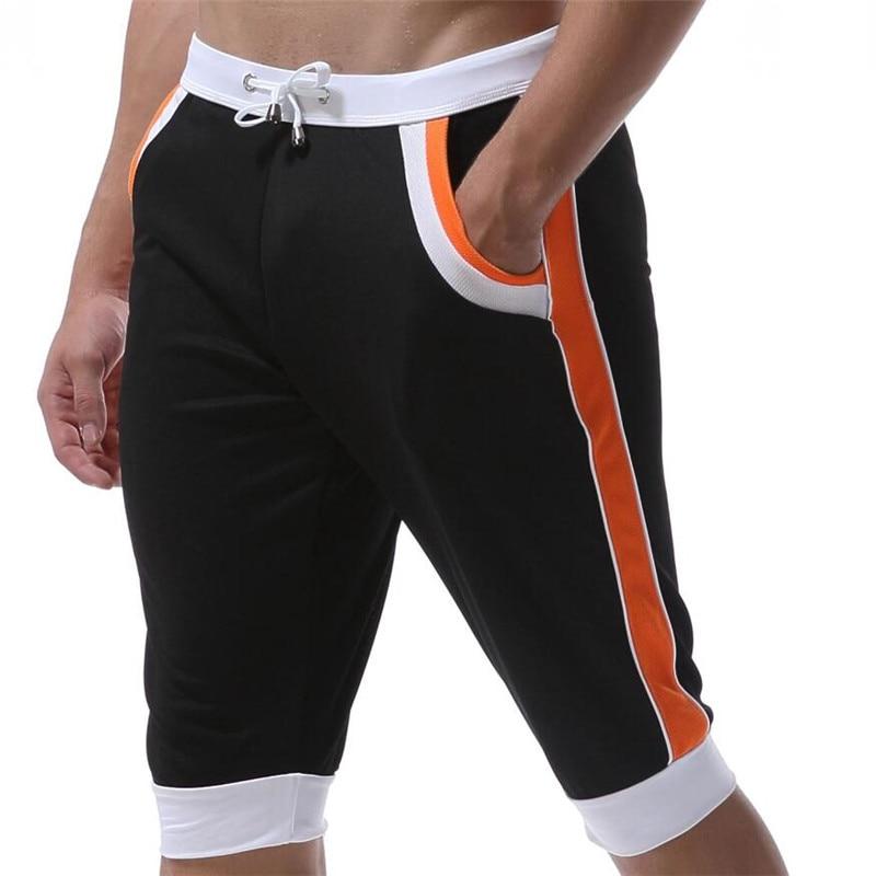Nuevo Verano de ocio Pantalones cortos para hombres pantalones elásticos de la marca para hombres Pantalones cortos Gimnasios de moda para hombre de secado rápido pantalones exteriores en casa