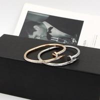 Nuova versione del chiodo della colla fango di perforazione coppia amore chiodo del braccialetto dei braccialetti delle donne di alta qualità in acciaio al titanio rosa braccialetto bracciale in oro