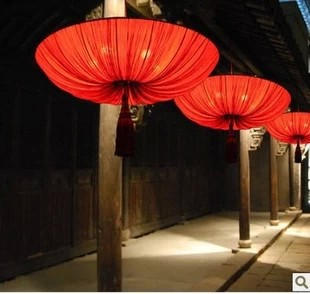 Modern new chinese fabric chandelier creative personality elliptic modern new chinese fabric chandelier creative personality elliptic big red lantern lamp light art light teahouse aloadofball Image collections