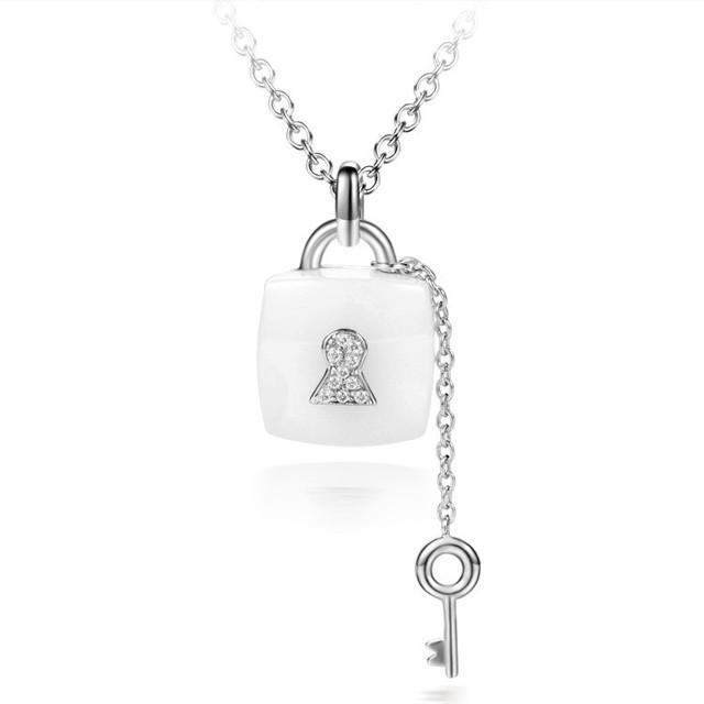 Cmajor cubic zirconia micro paved white ceramic pendant fashion key cmajor cubic zirconia micro paved white ceramic pendant fashion key lock ceramic pendants for women aloadofball Gallery