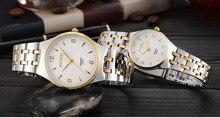 Envío de la gota top lujo de la marca del diseñador de moda de las mujeres de los hombres desgaste ocasional reloj de cuarzo correa de acero Inoxidable reloj de pulsera